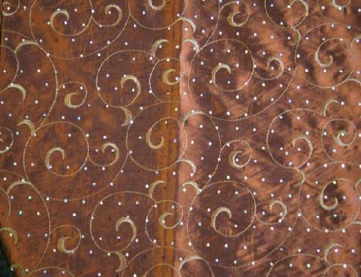 Where to find BROWN SWIRL WITH SPARKLE LINEN in Petoskey